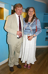 CHARLES KENNEDY and his wife SARAH at a party to celebrate the publication of Glass Houses by Sandra Howard held at Tamesa, Oxo Tower Wharf, Barge House Street, London SE1 on 5th September 2006.<br />