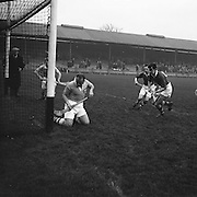 Dublin player attempts to save the slitor from his own goal during the National Hurling League, Cork v Dublin in Croke park on the 15th November 1953.