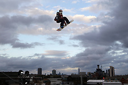 © Licensed to London News Pictures. 29/10/2011, London, UK.  Britain's Jamie Nicholls jumps during the final of FIS Snowboard World Cup Bir Air competition at the Freeze Snowboard and Ski Festival at Battersea Power Station in London, Saturday, Oct. 29, 2011. Photo credit : Sang Tan/LNP