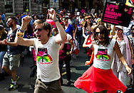 People dance, as they attend the annual Gay Pride parade in London, Britain, 29 June 2013. BOGDAN MARAN / BPA