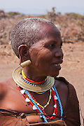 Portrait of a Datoga woman, in traditional dress and beads with deformed ear lobes. Photographed in Lake Eyasi, Tanzania