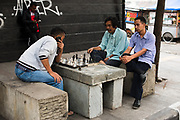 Men play chess on the sidewalk in Bandung