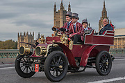 A 1902 James and Browne, Going over Westminster Bridge - Bonhams London to Brighton Veteran Car Run celebrates the 122nd anniversary of the original Emancipation Run of 1896 which celebrated the passing into law the Locomotives on the Highway Act so raising the speed limit for 'light automobiles' from 4mph to 14mph and abolishing the need for a man to walk in front of all vehicles waving a red flag. The Movember Foundation as our Official Charity Partner.