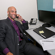 June 9, 2015, New Haven, CT:<br /> Former ATP World Tour star and Connecticut Open Legends Event Participant James Blake makes calls to ticket holders during a press conference at the Connecticut Tennis Center to announce the new Connecticut Open 50/50 Project and the renewal of United Technologies sponsorship of the tournament through the 2017 in New Haven, Connecticut Tuesday, June 9, 2015.<br /> (Photos by Billie Weiss/Connecticut Open)