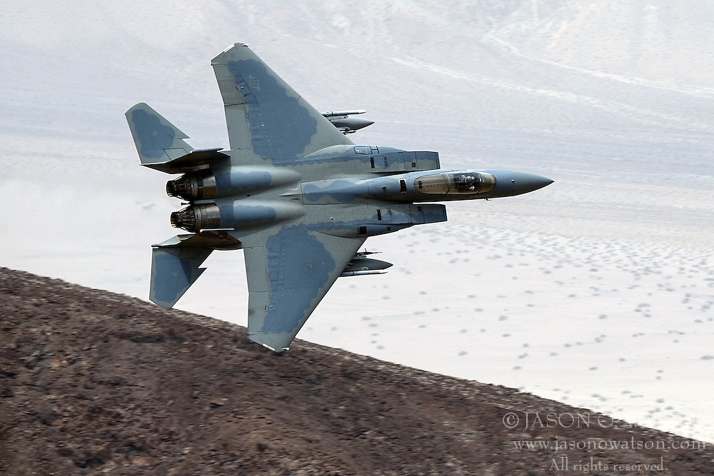 A McDonnell-Douglas F-15C Eagle (78-538), from the 144th Fighter Wing, California Air National Guard Base in Fresno, flies low level through the Jedi Transition, R-2508 complex, Star Wars Canyon / Rainbow Canyon, Death Valley National Park, California, United States of America.