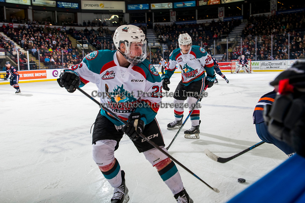 KELOWNA, CANADA - FEBRUARY 23: Liam Kindree #26 of the Kelowna Rockets looks for the puck against the Kamloops Blazers  on February 23, 2019 at Prospera Place in Kelowna, British Columbia, Canada.  (Photo by Marissa Baecker/Shoot the Breeze)