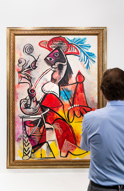 Man studies a Picasso painting