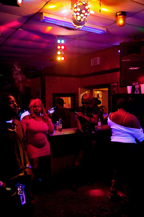 "Club-goers dance at Scruples Sports Bar in Itta Bena, Mississippi where friends and family of Demetrius ""Butta"" Anderson, 18, came to party into the night after Butta's funeral in the  Baptist Town neighborhood of Greenwood, Mississippi on Friday, November 5, 2010. Butta was shot and killed on October 27, 2010."