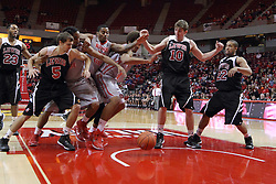 10 November 2014: Julian Lewis, Jeff Jarosz, Tony Wills, Deontae Hawkins, Reggie Lynch, Kyle Nelson, and Ryan Jackson all tangle to get a loose ball during an exhibition men's basketball game between Lewis University Flyers and the Illinois State Redbirds at Redbird Arena, Normal IL