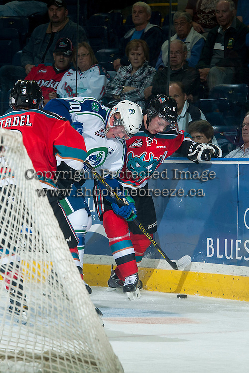 KELOWNA, CANADA - OCTOBER 7: Colten Martin #8 of Kelowna Rockets digs for the puck against Colby Cave #10 of Swift Current Broncos on October 7, 2014 at Prospera Place in Kelowna, British Columbia, Canada.  (Photo by Marissa Baecker/Getty Images)  *** Local Caption *** Colten Martin; Colby Cave;