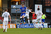 Lee Erwin of Oldham Athletic and Aaron Phillips of Northampton Town challenge for an aerial ball during the EFL Sky Bet League 1 match between Oldham Athletic and Northampton Town at Boundary Park, Oldham, England on 16 August 2016. Photo by Simon Brady.