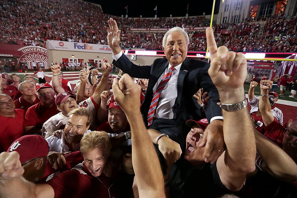 BLOOMINGTON, IN - AUGUST 31, 2017 - Former Indiana Hoosiers head coach Lee Corso is lifted up by his former players during the game against the Ohio State Buckeyes at Memorial Stadium in Bloomington, IN. <br /> Photo By Zach Bland/Indiana Athletics