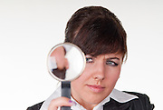 an attractive young woman looking thru  a loupe
