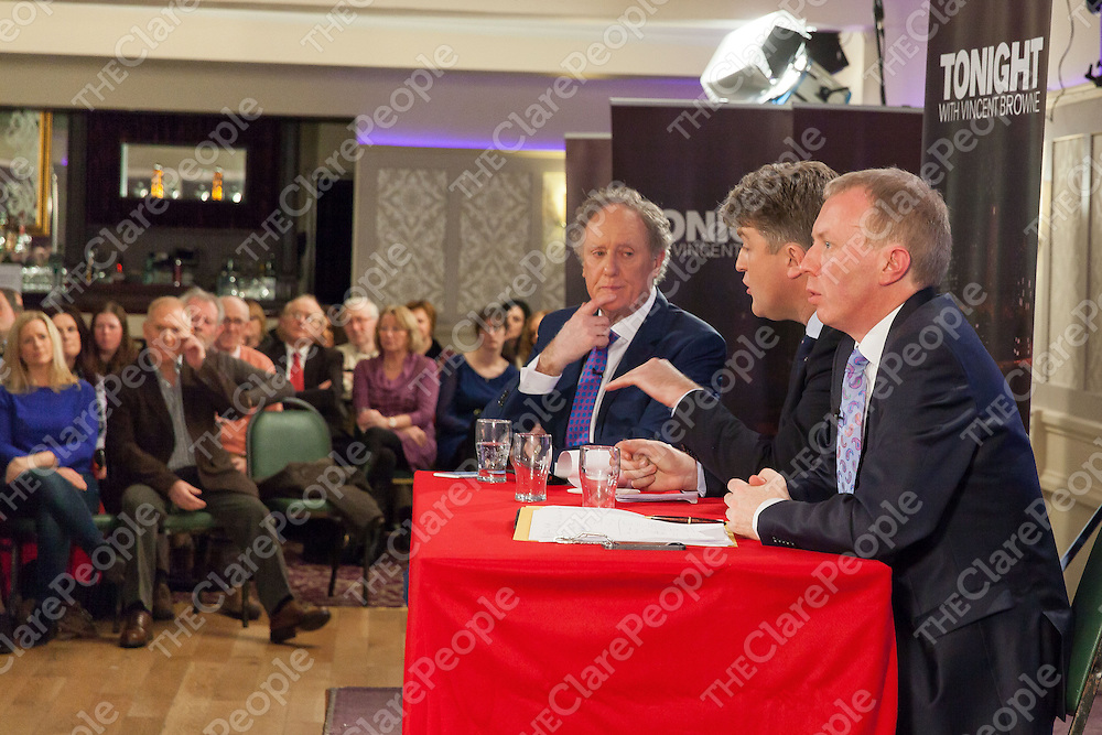Vincent Browne listening to Clare TD Michael McNamara during the peoples debate at the Auburn Lodge in Ennis