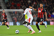Mamadou Sakho (12) of Crystal Palace is closed down by Joshua King (17) of AFC Bournemouth during the Premier League match between Bournemouth and Crystal Palace at the Vitality Stadium, Bournemouth, England on 1 October 2018.