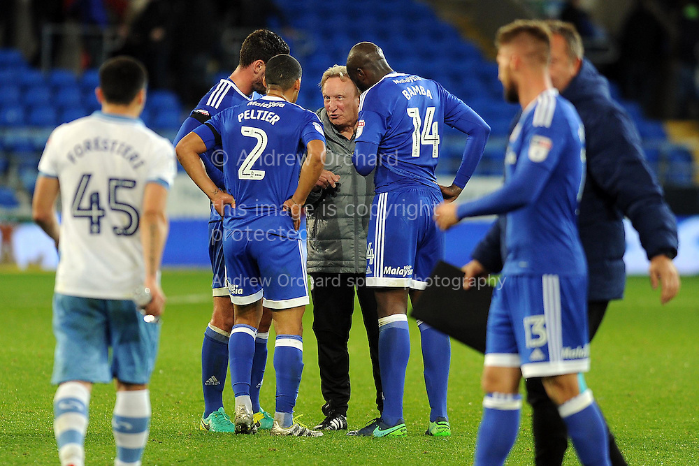 Cardiff City manager Neil Warnock &copy; discusses tactics with a few of the Cardiff players after the match.  EFL Skybet championship match, Cardiff city v Sheffield Wednesday at the Cardiff city stadium in Cardiff, South Wales on Wednesday 19th October 2016.<br /> pic by Carl Robertson, Andrew Orchard sports photography.