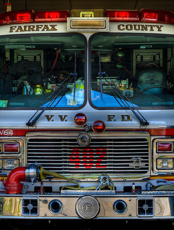 An HDR image of the front of a fire engine parked in the Vienna Volunteer Fire Department firehouse, Vienna, Virginia.