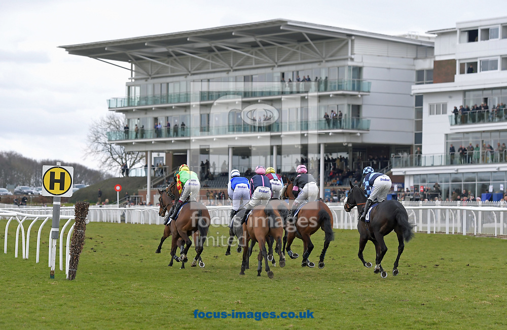 Runners in 5th race Watch racing UK on Sky 432 Novice Hurdle set off on 1st circuit  during the Wear A Hat Day meeting  at Wetherby Racecourse, West Yorkshire<br /> Picture by Martin Lynch/Focus Images Ltd 07501333150<br /> 29/03/2018