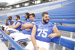 Kentucky guard Zach West talks with teammates during the University of Kentucky's annual media day, Friday, Aug. 07, 2015 at Commonwealth Stadium in Lexington.