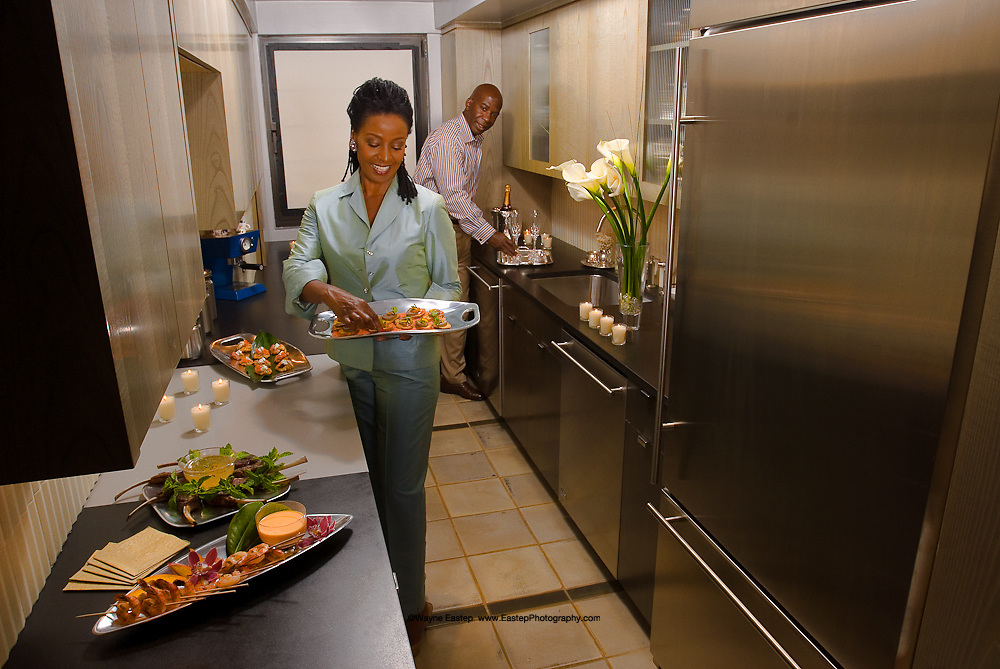 B. Smith and Dan Gasby in condominium kitchen in Manhattan overlooking Central Park. GE-Monogram Advertising Campaign