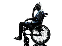 one injured man on the telephone happy in wheelchair in silhouette studio on white background