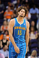 Apr 7, 2013; Phoenix, AZ, USA; New Orleans Hornets center Robin Lopez (15) reacts on the court in the first half of the game against the Phoenix Suns at US Airways Center. The Hornets defeated the Suns 95-92. Mandatory Credit: Jennifer Stewart-USA TODAY Sports