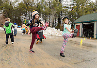 """Abby and Delaney doing straight leg toe touches during the parking lot races with Meredith Parks and Recs """"day campers"""" on Thursday.   (Karen Bobotas/for the Laconia Daily Sun)"""