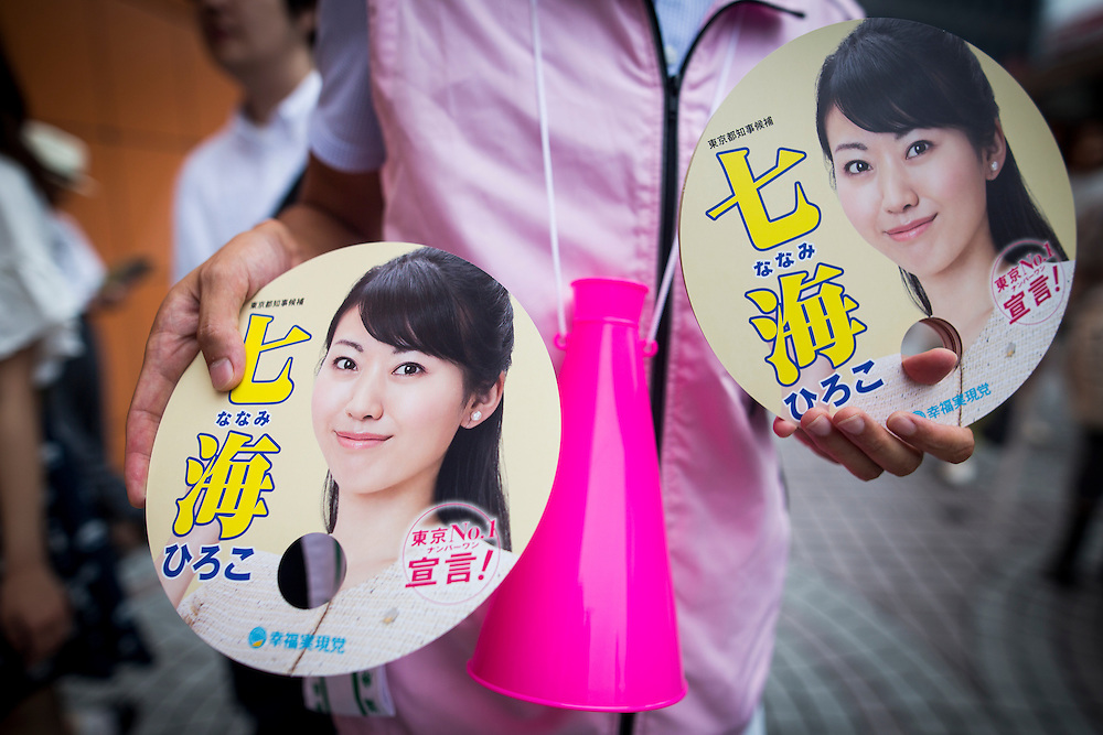 TOKYO, JAPAN - JULY 22 : Campaign leaflets of Candidate Hiroko Nanami from Happiness Realization Party being distributed during a Tokyo Gubernatorial Election 2016 campaign rally at Shinjuku station, Tokyo, Japan on Friday, July 22, 2016. Tokyo residents will vote on July 31 for a new Governor of Tokyo who will deal with issues related to the hosting of the Tokyo Summer Olympics and Paralympics in 2020. (Photo: Richard Atrero de Guzman/NUR Photo)