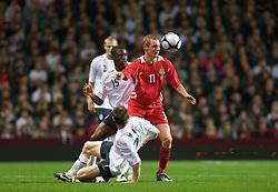 BIRMINGHAM, ENGLAND - Monday, October 13, 2008: Wales' Shaun MacDonald and England's James Milner during the UEFA European Under-21 Championship Play-Off 2nd Leg match at Villa Park. (Photo by Gareth Davies/Propaganda)