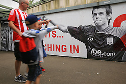 13 August 2016 - Premier League - Southampton v Watford - Southampton fans point at a mural of long departed former player Gareth Bale - Photo: Marc Atkins / Offside.