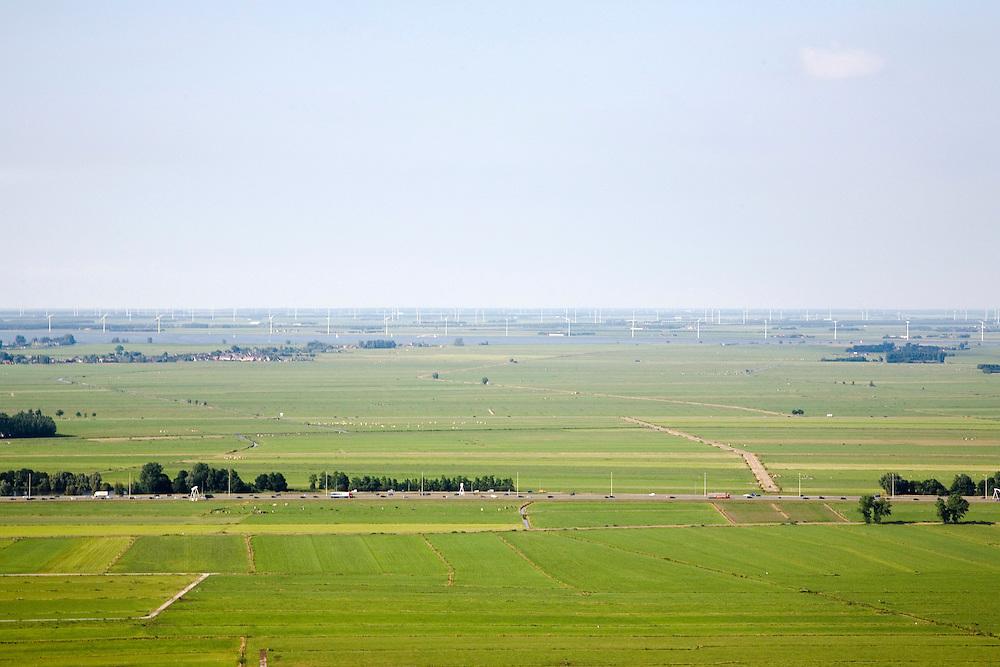 Nederland, Utrecht, Bikkerspolder, 28-06-2006; luchtfoto (25% toeslag een van de laatste open veenweide landschappen in de Noordoostelijke Randstad, polders tussen Bunschoten-Spakenburg en Eemnes, direkt ten Noorden van autosnelweg A1; aan de horizon de randmeren (Eemmeer) met windmolens in Flevoland;  windturbines, weiland, landbouw, veeteelt, natuurbeheer; ruimtelijke ordening; infrastructuur; verkeer en vervoer; .luchtfoto (toeslag aerial photo (additional fee required .foto Siebe Swart / photo Siebe Swart