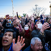 People try to catch rice cakes thrown from above during Honen-sai, a fertility festival at Tagata Shrine in Komaki, Aichi Prefecture, Japan. The traditional Shinto festival celebrates fertility and a bountiful harvest.