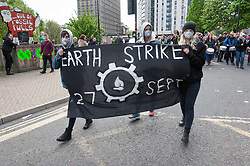 "© Licensed to London News Pictures. 27/04/2019. Bristol, UK. Earth Day Climate Protest and Bristol Bearpit Takeover by Earth Strike UK with marchers blocking roads and holding up traffic in Bristol city centre. The event was held on the weekend after Earth Day, holding protests across the country over climate change and against pollution to symbolise the halfway mark to the Earth Strike. The Bristol event had free music, food, workshops and was located at the ""Bearpit"" St James Barton roundabout, a major road junction in the city centre with a sunken roundabout which is currently partly squatted. The campaign is against new pipelines, airports and fracking sites, and wants sustainable energy, clean water, decent housing and respect for all people. Photo credit: Simon Chapman/LNP"