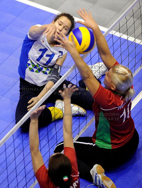 09-10-2011 VOLLEYBAL: EUROPEAN CHAMPIONSHIP SITTING VOLLEYBALL: ROTTERDAM<br /> Slovenia - Hungary / (L-R) Lena Gabrscek SLO and Barbara Nebehaj HUN<br /> &copy;2011-FotoHoogendoorn.nl