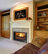 Cozy living room with fireplace leather armchair and walkout deck