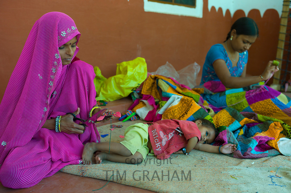 Indian women sewing textiles at Dastkar women's craft co-operative, the Ranthambore Artisan Project, in Rajasthan, Northern India