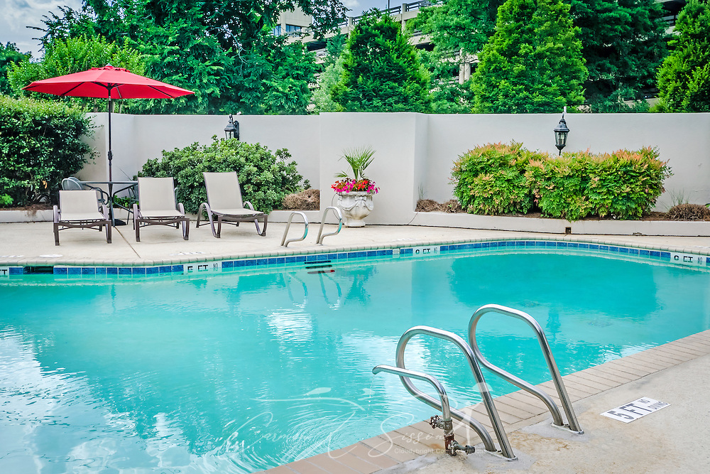 """A swimming pool is ready for the summer season at University Inn, a family-owned hotel located near Emory University in Atlanta, Georgia, May 29, 2014. The inn opened in January 1971 and offers 60 rooms to meet the lodging needs of University parents and other Atlanta visitors. It was featured on the Travel Channel's """"Hotel Impossible,"""" May 26, 2014. (Photo by Carmen K. Sisson/Cloudybright)"""