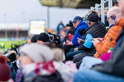 A fan watches the big screen with an in ear referee headphone set during the game - Mandatory by-line: Ryan Hiscott/JMP - 03/11/2018 - RUGBY - Sandy Park Stadium - Exeter, England - Exeter Chiefs v Bath Rugby - Premiership Rugby Cup