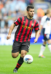 BOLTON, ENGLAND - Sunday, August 21, 2011: Manchester City's Sergio Aguero in action against Bolton Wanderers during the Premiership match at the Reebok Stadium. (Pic by David Rawcliffe/Propaganda)