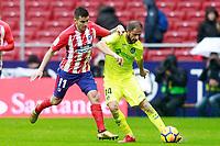 Atletico de Madrid's Angel Correa (l) and Getafe CF's Sergio Mora during La Liga match. January 6,2018. (ALTERPHOTOS/Acero)