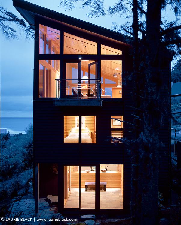 Beach house exterior at dusk.