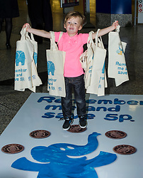Environment minister Richard Lockhead launced a new public awareness campaign ahead of the introduction of a 5p charge for each single use carrier bag given to shoppers. Pictured Isaac Lee (aged 3) Edinburgh,  25 September 2014 Ger Harley | StockPix.eu