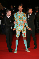 CANNES, FRANCE - DECEMBER 14:  Stromae arrives at the 15th NRJ Music Awards at the Palais des Festivals on December 14, 2013 in Cannes, France.  (Photo by Tony Barson/FilmMagic)