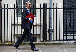 © Licensed to London News Pictures. 13/03/2018. London, UK. The Chancellor of The Exchequer Philip Hammond leaves 11 Downing Street as he heads to Parliament to deliver the Spring Statement. Photo credit: Rob Pinney/LNP