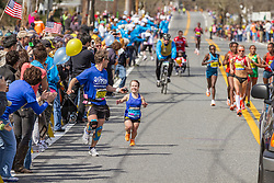 2014 Boston Marathon: small statured runner Juli Windsor watches as elite women race by