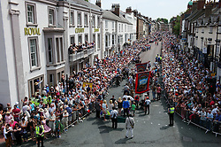 """© Licensed to London News Pictures. 13/07/2013<br /> <br /> Durham City, England, United Kingdom<br /> <br /> Thousands of people watch as colliery bands and banners march through the city of Durham during the Miners Gala.<br /> <br /> The Durham Miners' Gala is a large annual gathering held each year in the city of Durham. It is associated with the coal mining heritage of the Durham Coalfield, which stretched throughout the traditional County of Durham, and also gives voice to miners' trade unionism. <br /> <br /> Locally called """"The Big Meeting"""" or """"Durham Big Meeting"""" it consists of banners, each typically accompanied by a brass band, which are marched to the old Racecourse, where political speeches are delivered. In the afternoon a Miners' service is held in Durham Cathedral <br /> <br /> Photo credit : Ian Forsyth/LNP"""