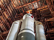 "Abandoned since the 1970's Soviet rocket still stands tall in disused hanger<br /> <br /> In the late 70's of the last century,  Soviet Union began to develop a superheavy rocket called ""Energy."" <br /> <br /> Energy was a Soviet rocket that was designed by NPO Energia to serve as a heavy-lift expendable launch system as well as a booster for the Buran spacecraft. <br /> <br /> It flew for the first time in 1987, and in 1988 brought to Earth orbit the reusable space shuttle Buran. On its basis, the Energia-M rocket was designed.<br /> <br /> The rocket had the capacity to place about 100 tonnes in Low Earth orbit, up to 20 tonnes to geostationary orbit and up to 32 tonnes to a translunar trajectory.<br /> <br /> The Energia was designed to launch the Russian ""Buran"" reusable shuttle,and for that reason was designed to carry its payload mounted on the side of the stack, rather than on the top, as is done with other launch vehicles. After design of the Energia-Buran system, it was also proposed that the booster could be used without the Buran as a heavy-lift cargo launch vehicle; this configuration was originally given the name ""Buran-T"". This configuration required the addition of an upper stage to perform the final orbital insertion.[6] The first launch of the Energia was in the configuration of a heavy launch vehicle, with the large Polyus military satellite as a payload, however Polyus failed to correctly perform the orbital insertion.<br /> <br /> On December 25, 1991, the mock-up  was placed on the launch pad, and two days later the layout was returned back to the Dynamic Test Building.  The doors was closed, and work on the development of the rocket was stopped.  The main reason is the collapse of the USSR and the difficult economic situation.<br /> ©Ralph Mirebs/Exclusivepix Media"