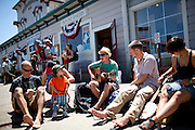 Ben Geilhufe, center, plays outside the Bovine Bakery in Pt. Reyes Station, Calif., July 2, 2011.