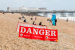 © Licensed to London News Pictures. 28/06/2020. Brighton, UK. Members of the public enjoy the milder weather on the beach in Brighton and Hove. Photo credit: Hugo Michiels/LNP