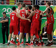 14th April 2018, Gold Coast Convention and Exhibition Centre, Gold Coast, Australia; Commonwealth Games day 10, Basketball, Mens semi final, New Zealand versus Canada; Canadian players celebrate their victory over New Zealand by 2 points with Mamadou Gueye who scored the winning points on the buzzer